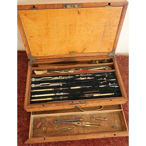 7 - Edwardian oak cased architect's case with hinged lift up top, fold out section with various trays co...