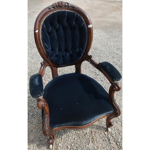 110 - Victorian carved rosewood framed armchair with upholstered seat, back and arms...