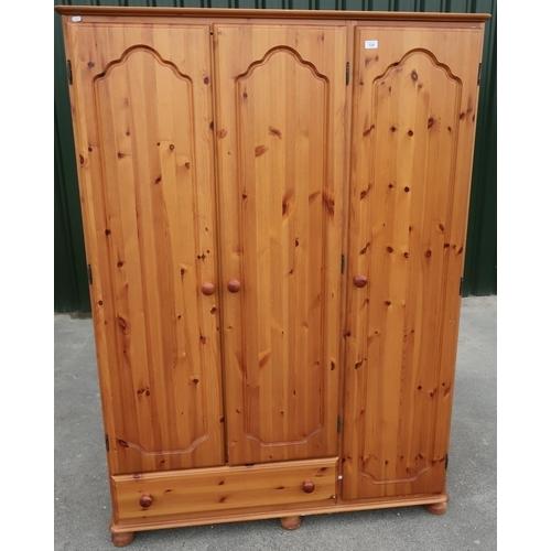 128 - Modern pine triple door wardrobe with single drawer to the base (width 124cm)...
