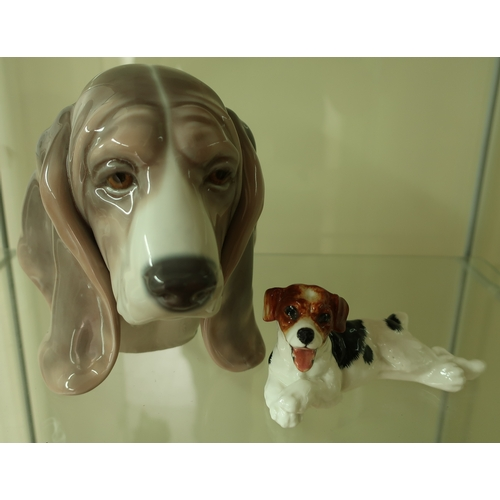 2 - Lladro figure of a dogs head (height 14cm) and a Royal Doulton figure HM1101 of a terrier (2)...