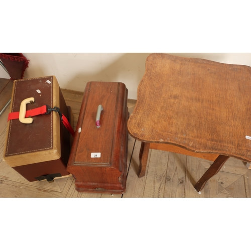 25 - Wooden cased vintage sewing machine, another later sewing machine and an oak sewing table (3)...