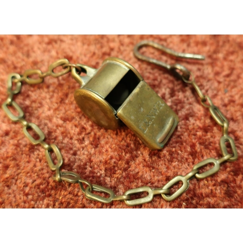 35 - D & N.W.R railway whistle and chain...