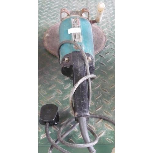 25 - Makita electric grinder...
