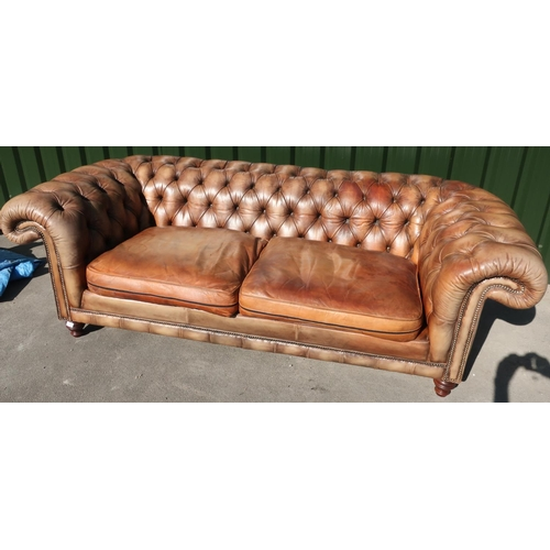 286 - Superb quality Victorian style tan leather deep button back Chesterfield style sofa (width 230cm)...