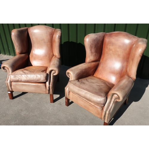 288 - Pair of quality 19th C style tan leather wingback armchairs with brass studded detail and square sup...