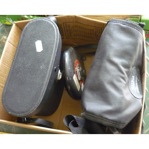 22 - Box containing two sets of binoculars, one in hard case and one in soft case and a 15m measuring tap...