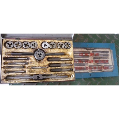 43 - Two boxes containing metric and metric fine thread tap and die sets...