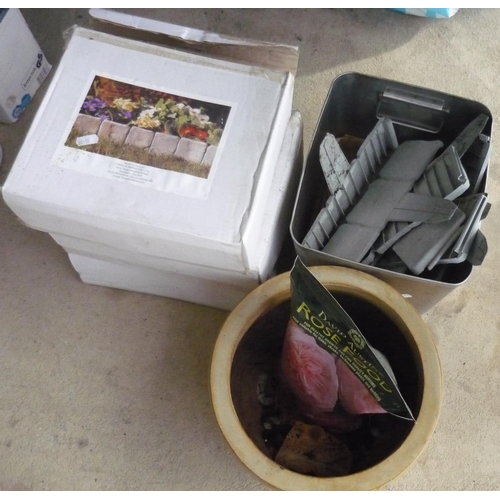 7 - Three boxes and a quantity of garden edging dividers, a pot and bag of rose food...