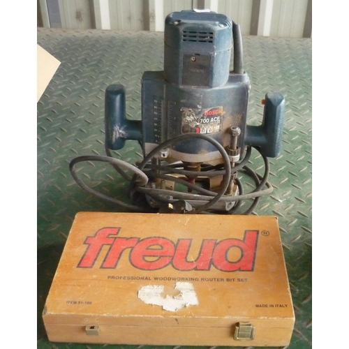 9 - Bosch Professional router and a box of Freud Professional woodworking router bits...