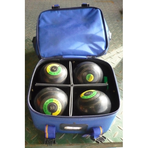 6 - Bag containing four York and district IBC bowls and falcon measurer...