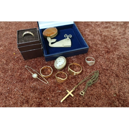 235 - Gents gold signet ring stamped 375, gold crucifix stamped 375, small gold signet ring stamped 375, c...