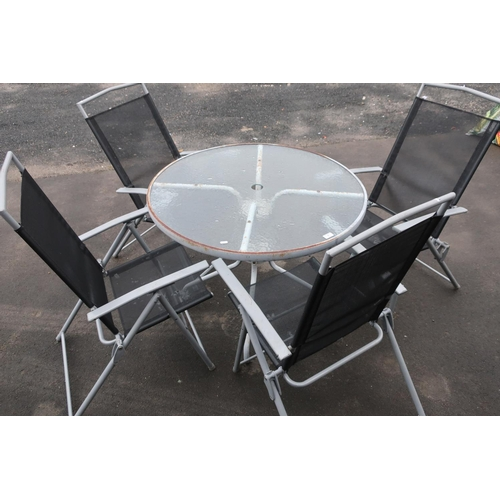 1 - Set of four garden chairs with glass topped table...