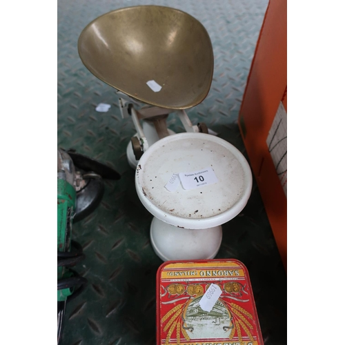 10 - Set of kitchen scales with brass dish and a tin containing various weights...