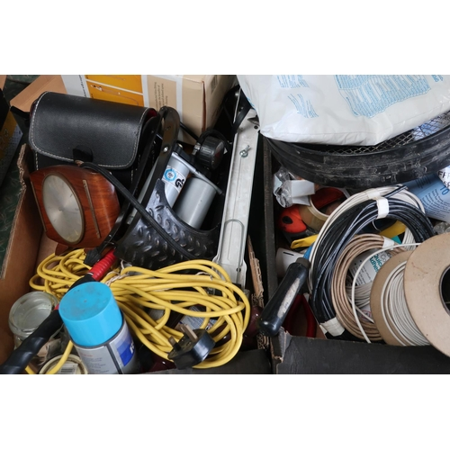 16 - Two boxes containing a quantity of tools including cables, foot pump, binoculars, small file, shower...