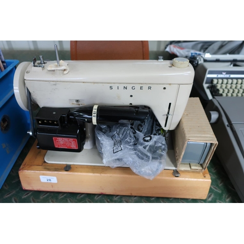 28 - Singer electric sewing machine with carrying case...