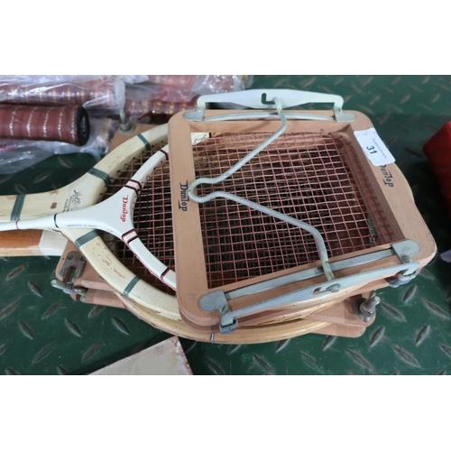 31 - Set of three rackets including Dunlop, squash racket, Slazenger tennis racket and a Jack Raphael ten...