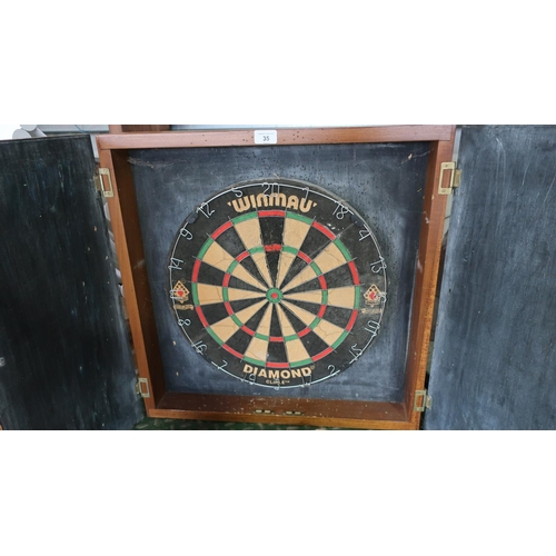 35 - Trebles board in a well constructed joiner made cupboard with chalk boards...
