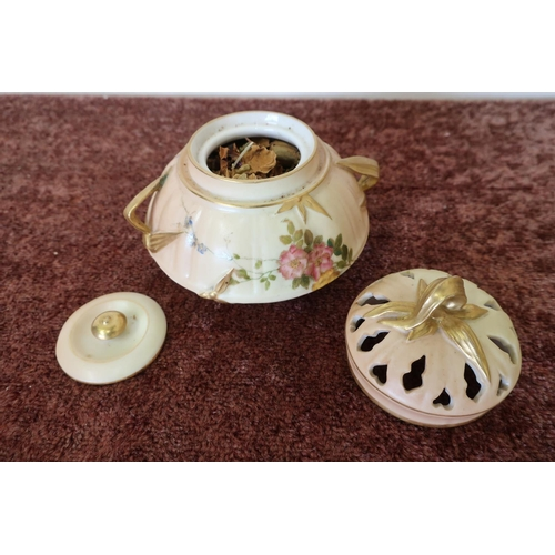37 - Royal Worcester potpourri holder with pierced lift off lid  and further solid lid, with twin handles...