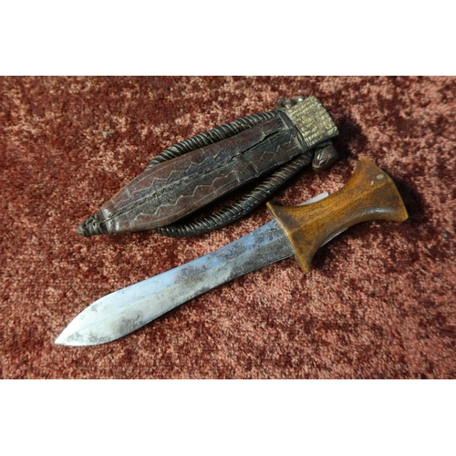 33 - North African arm dagger with 5 1/2 inch swollen blade, wooden grip and leather sheath with braided ...