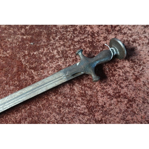 52 - Indian Tulwar type sword with curved 28 1/2 inch double fullered blade and disc shaped pommel...