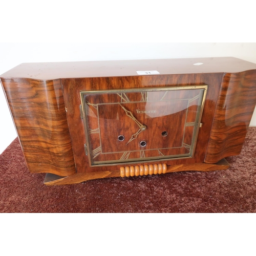 31 - Art Deco period walnut cased mantel clock by Vedette, Westminster chiming movement...