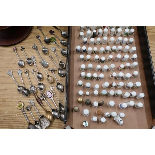 44 - Souvenir bone china thimbles and a small collection of souvenir spoons...
