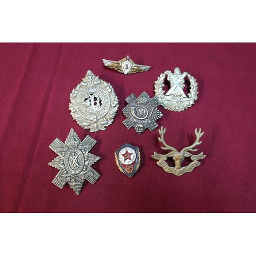 22 - Small selection of Scottish cap badges including Highland Light Infantry and two Soviet Union enamel...