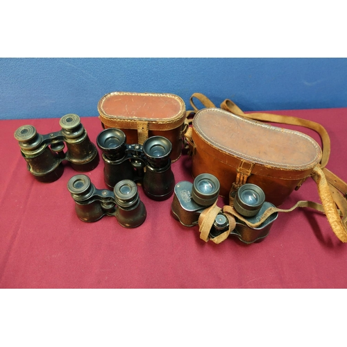 28 - Four various pairs of binoculars, two with leather cases, early-mid 20th C including French and Carl...