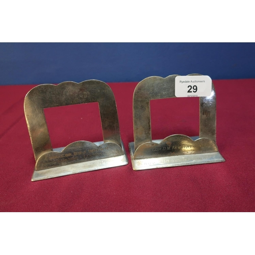 29 - Two silver plated place name holders, possible from the RAF Club by Harrison Brothers, No. 3479 with...