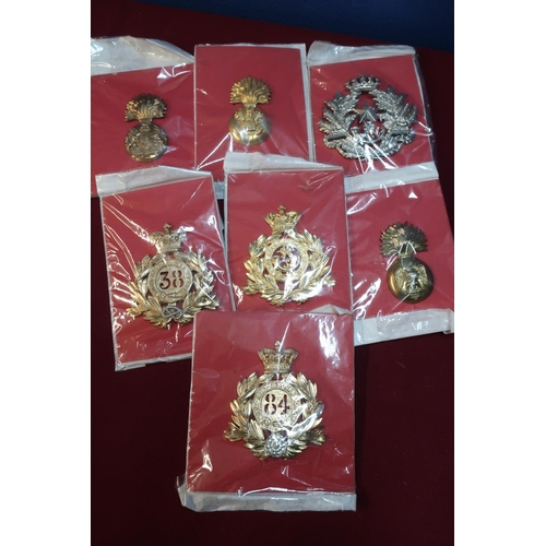 42 - Seven mounted large quality reproduction Victorian cap badges...