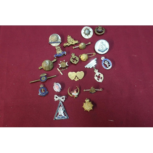 44 - Quantity of various military related sweetheart and other lapel badges and brooches including Mother...