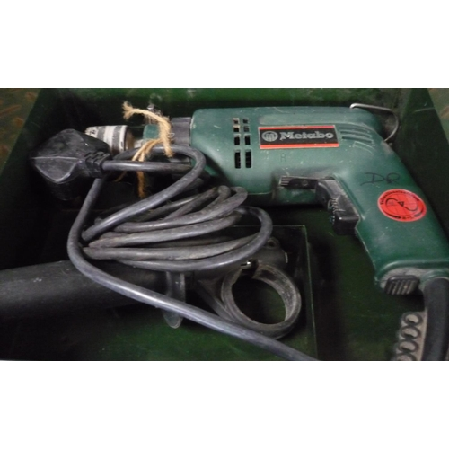 32 - Metabo cased electric drill...