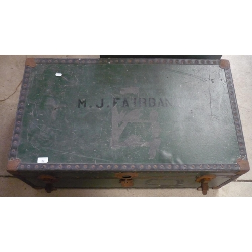53 - Large travelling trunk with the name M J Fairbank and metal fastenings...