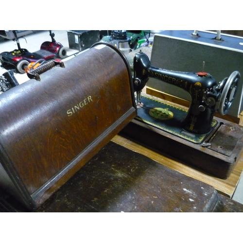 57 - Cased vintage Singer sewing machine...