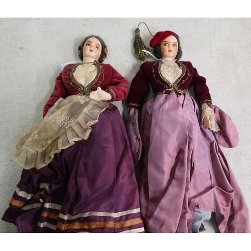 14 - Two early - mid 20th C Portuguese style dolls in traditional dress (height 30cm)...