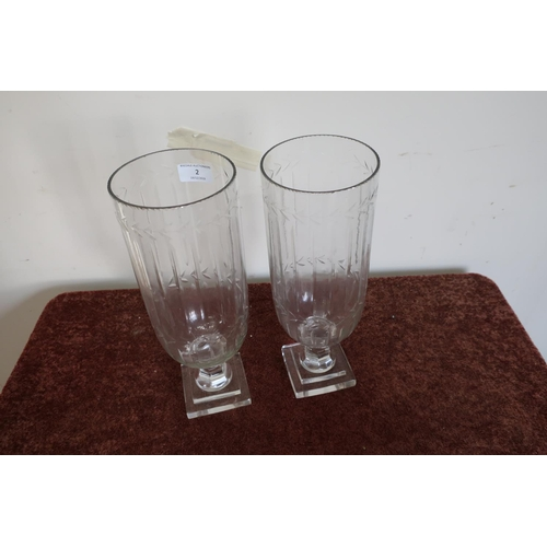 2 - Pair of glass vases with etched and fluted design and stepped square bases (34cm high)...