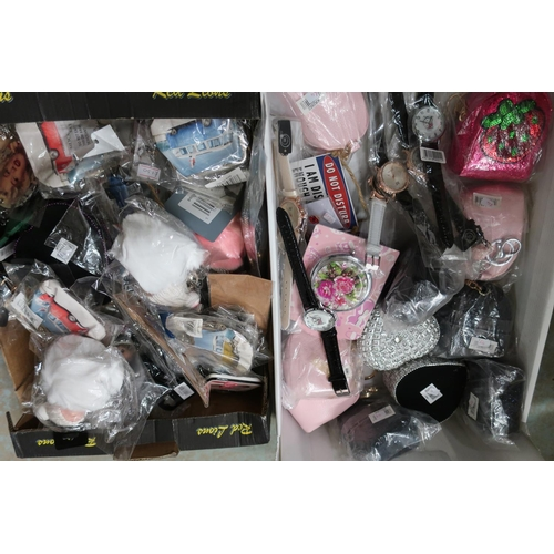 56 - Ex shop stock fashion watches, heart shaped trinket dishes, and keyrings in two boxes...