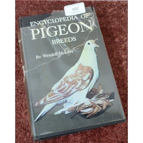 102 - The Encyclopedia of Pigeon Breeds by Wendell M. Levi, published by T.F.H Publications...