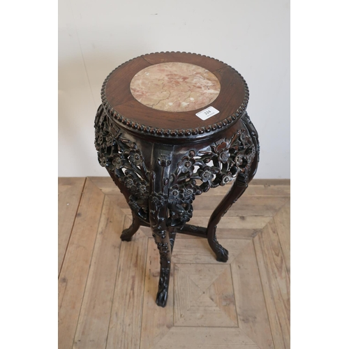 220 - Chinese hardwood jardiniere stand with inset hard stone panel to the top, with elaborately carved de...