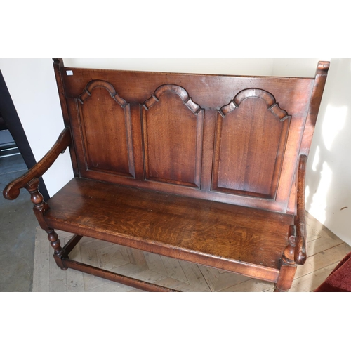 221 - Oak triple panelled back hall bench/settle on turned supports with planked seat (width 135cm)...