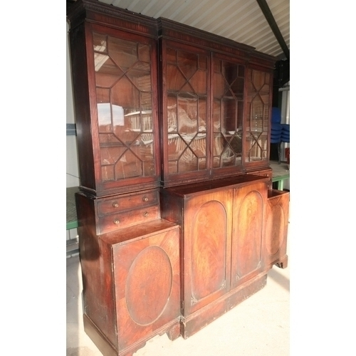 256 - 19th C mahogany breakfront bookcase by Gillows with upper central section enclosed by two glazed doo...