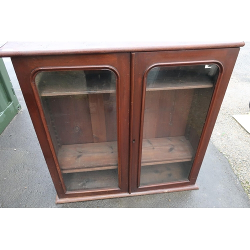 260 - Late Victorian mahogany bookcase enclosed by two glazed cupboard doors with later stained pine top (...