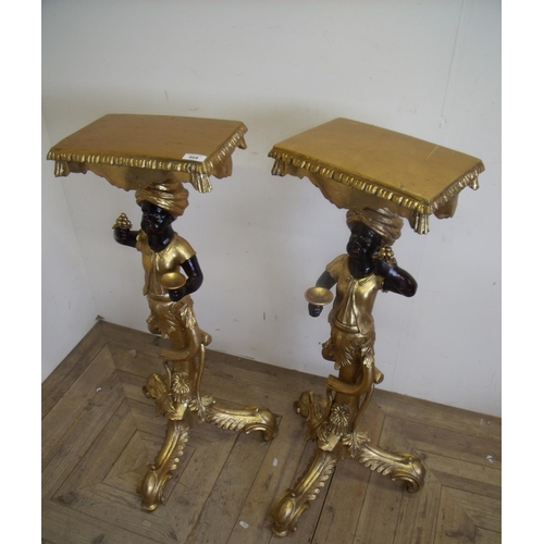326 - Pair of gilt Blackamoor style torchere stands with rectangular tops (height 93cm)...