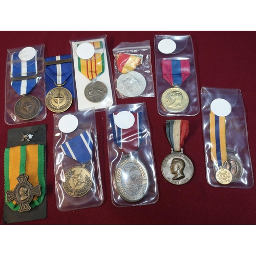 25 - Group of ten various foreign and national medals including Nato, Kosovo and Non Article 5, French me...