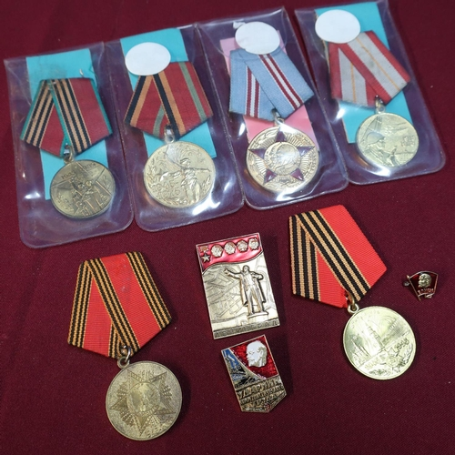 27 - Group of six Soviet Russian medals and three Russian badges including USSR Medal Celebrating 60 Year...