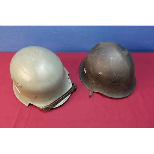 32 - German Third Reich Civil steel helmet with leather liner and chin strap, with later painted detail a...