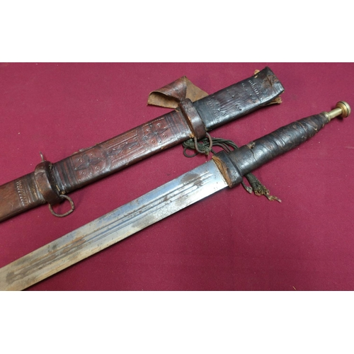 43 - North African Sudanese style sword with 31 inch double edge blade with leather bound grip and leathe...