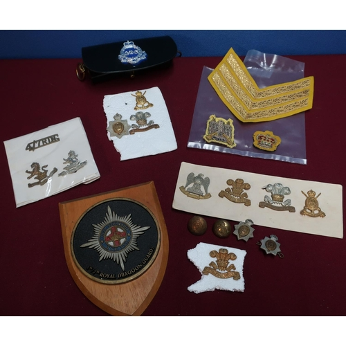 100 - Selection of British Army regimental cap badges for various Dragoon Guard regiments including the 3r...