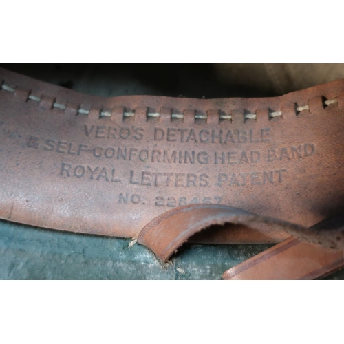 31 - Two circa WWII period British military pith helmets, one with leather liner and chin strap marked Ve...