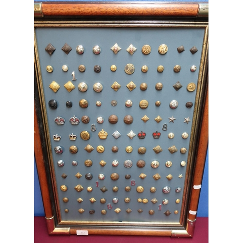 112 - Framed and mounted display of military buttons, pips and insignia for various British and overseas r...